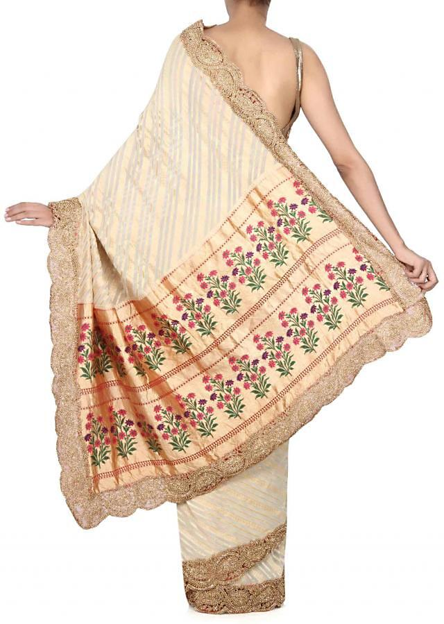 Striking cream saree features with brocade pallav only on Kalki