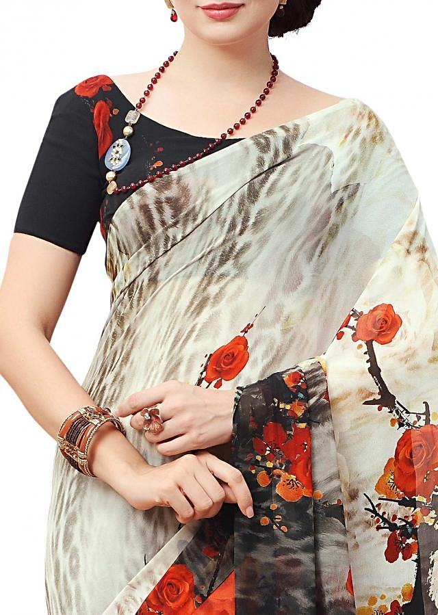 Cream saree features with floral print