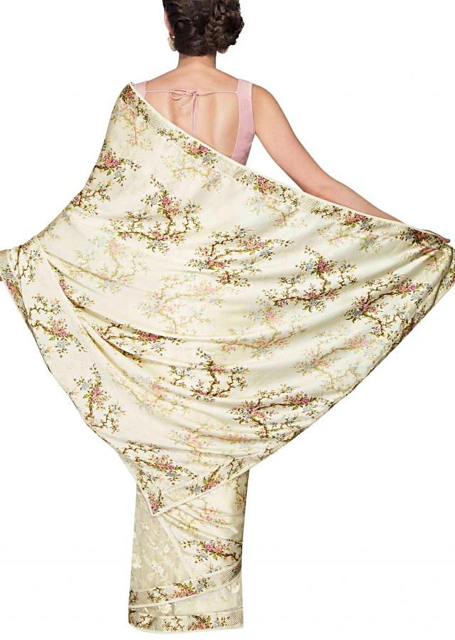 Cream satin and net saree with floral prints only on Kalki