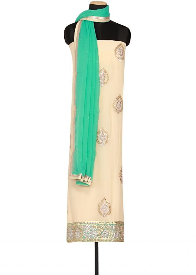 Cream satin un-stitched salwar-kameez embellished in zardosi only on Kalki