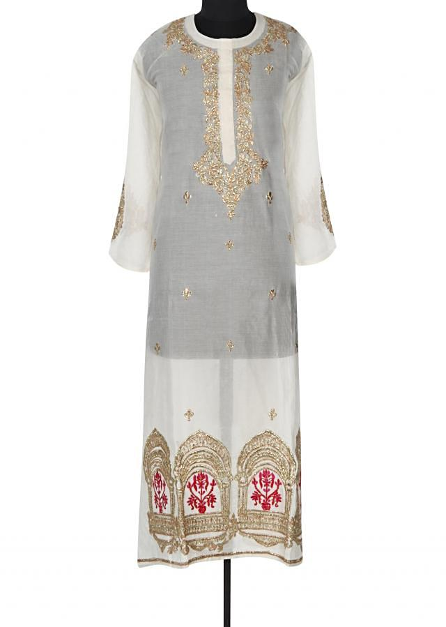 Cream semi stitched suit adorn in resham and zari only on Kalki