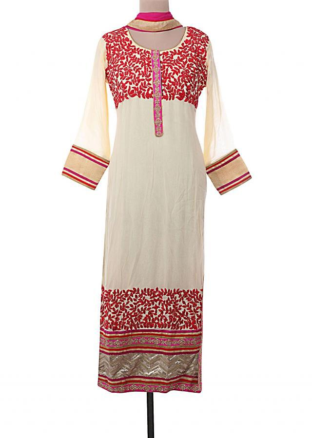 Cream semi-stitched suit embellished in resham embroidery and kardana only on Kalki