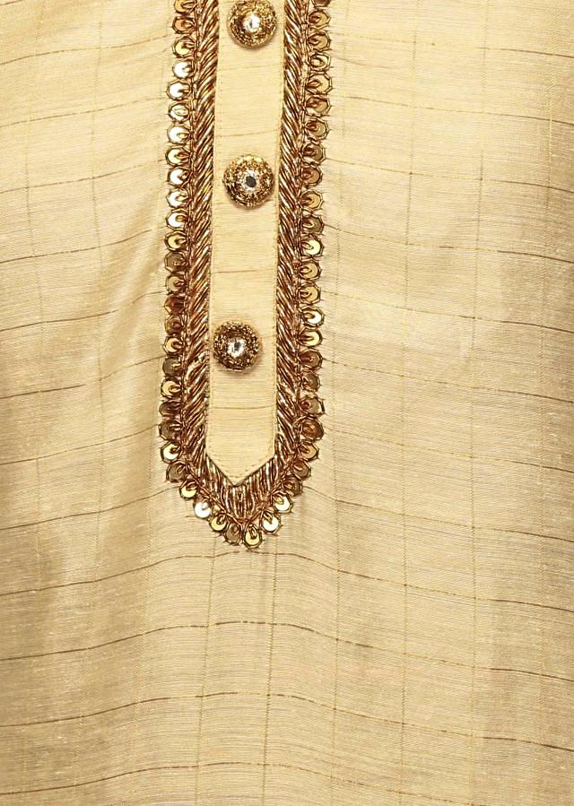 Cream semi stitched suit with royal blue dupattaonly on Kalki