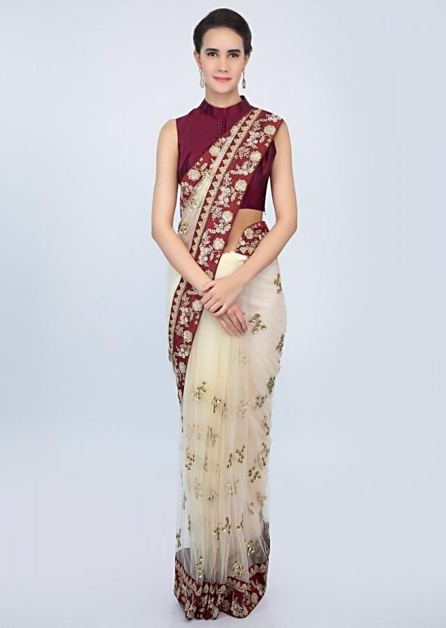 Cream Saree In Sheer Embroidered Net With Contrasting Wine Raw Silk Border Online - Kalki Fashion