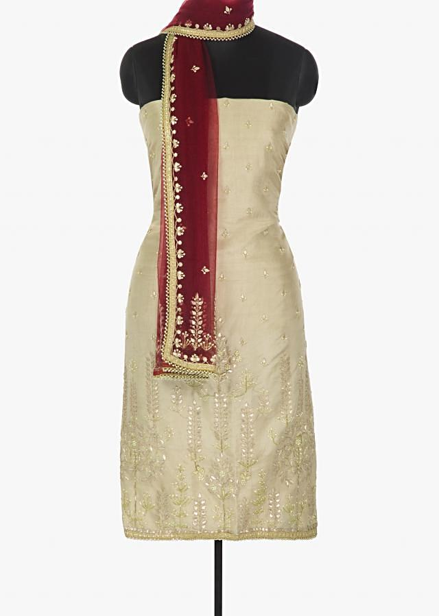 Cream silk unstitched suit enriched with gotta patch and moti work only on Kalki