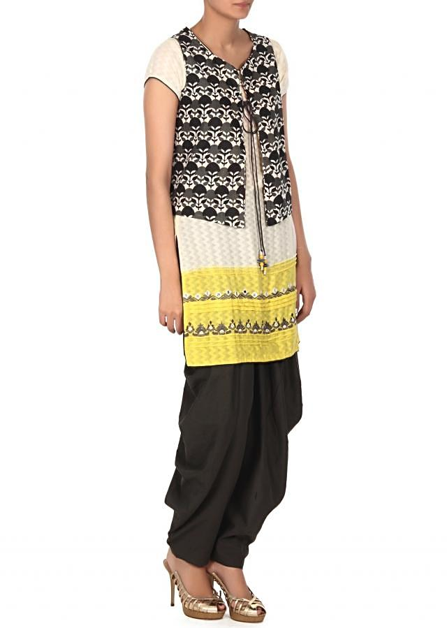 Cream straight suit Matched with printed jacket only on Kalki