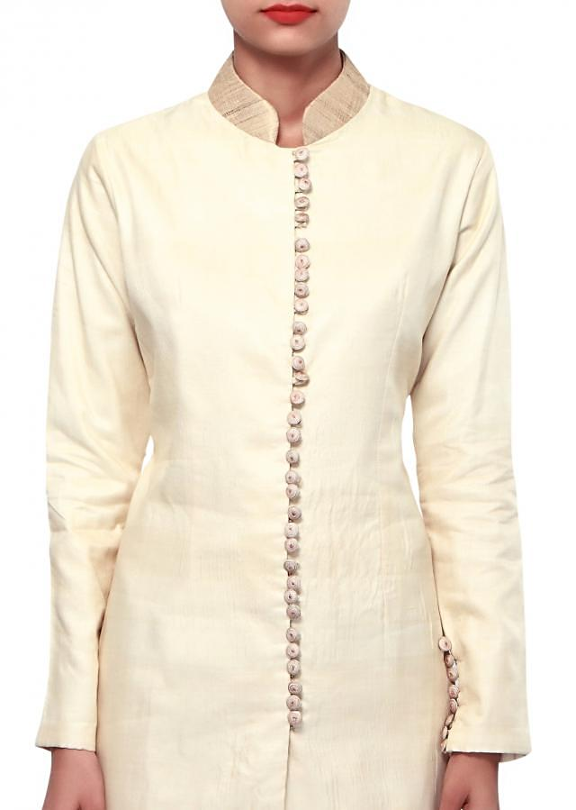 Cream suit adorn in resham embroidery only on Kalki