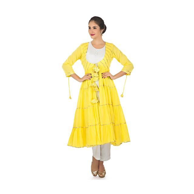 Cream top and pant matched with a cotton yellow jacket with gathers only on Kalki