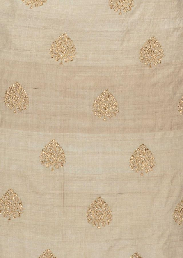 Cream tussar silk unstitched suit enhanced  with zari and resham butti only on Kalki
