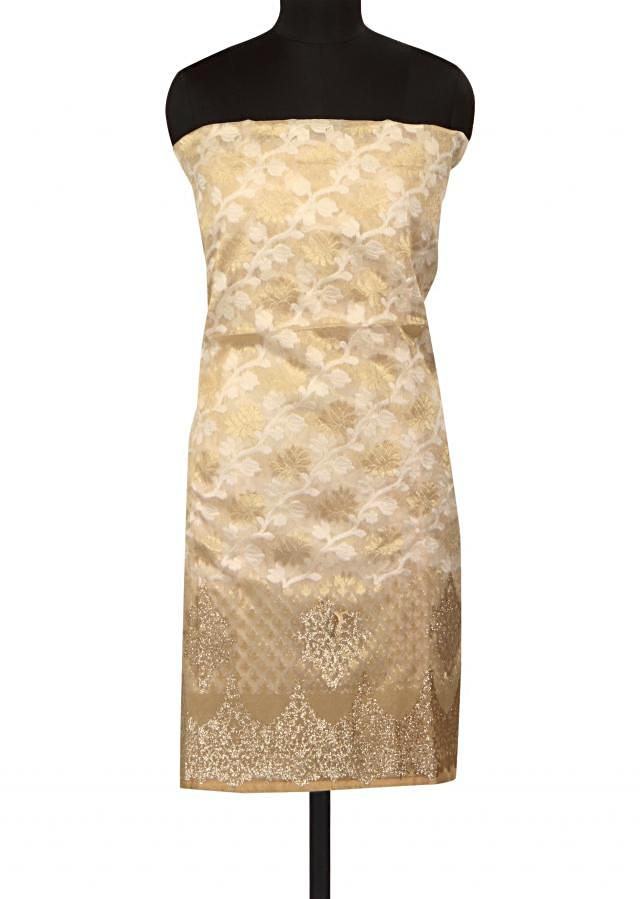 Cream unstitched suit adorn in applique embroidery only on Kalki