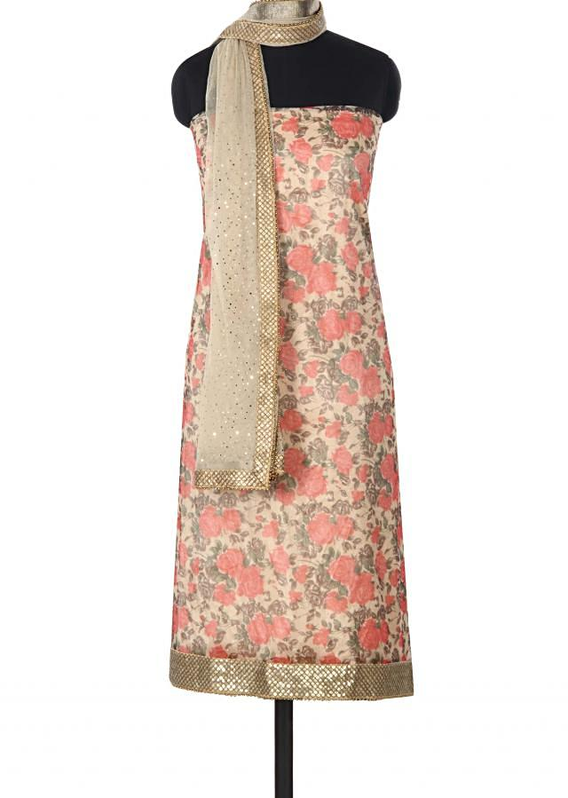 Cream unstitched suit adorn in floral print only on Kalki