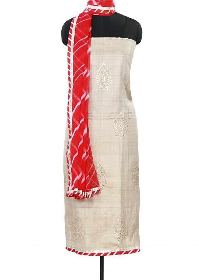 Cream unstitched suit adorn in gotta patch butti only on Kalki