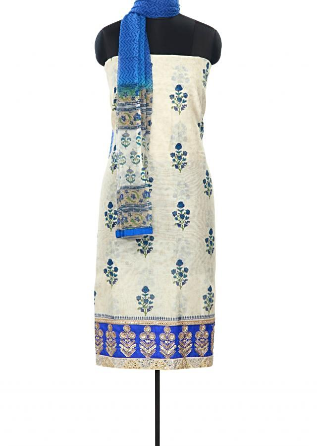 Cream unstitched suit enhanced in print and sequin work only on Kalki