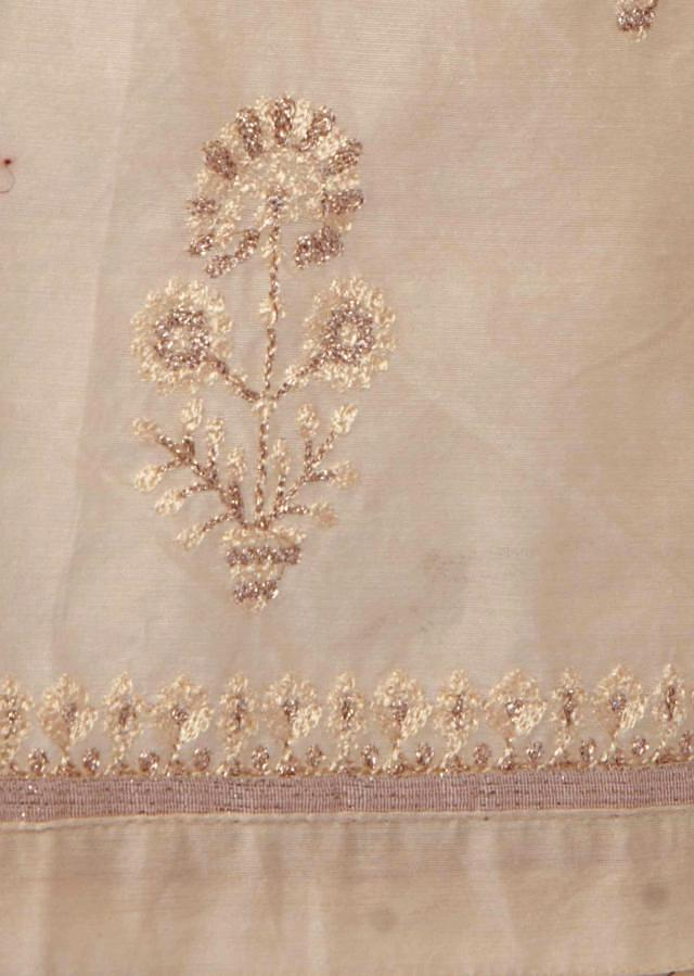 Cream unstitched suit in resham and zari butti only on Kalki