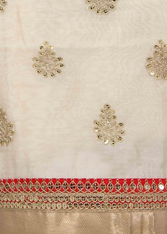 Cream unstitched suit in sequin nad zari butti only on Kalki