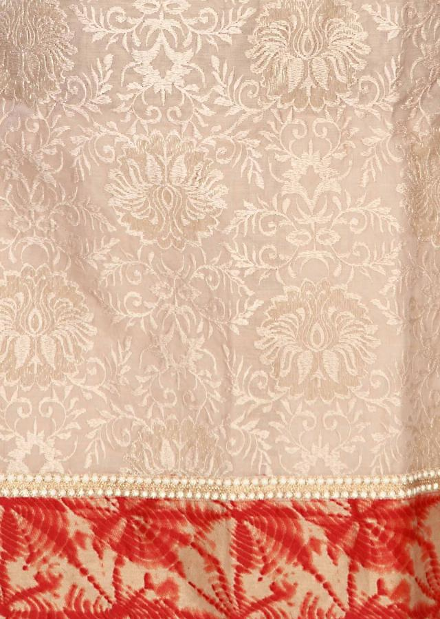 Cream unstitched suit matched with printed dupatta only on Kalki