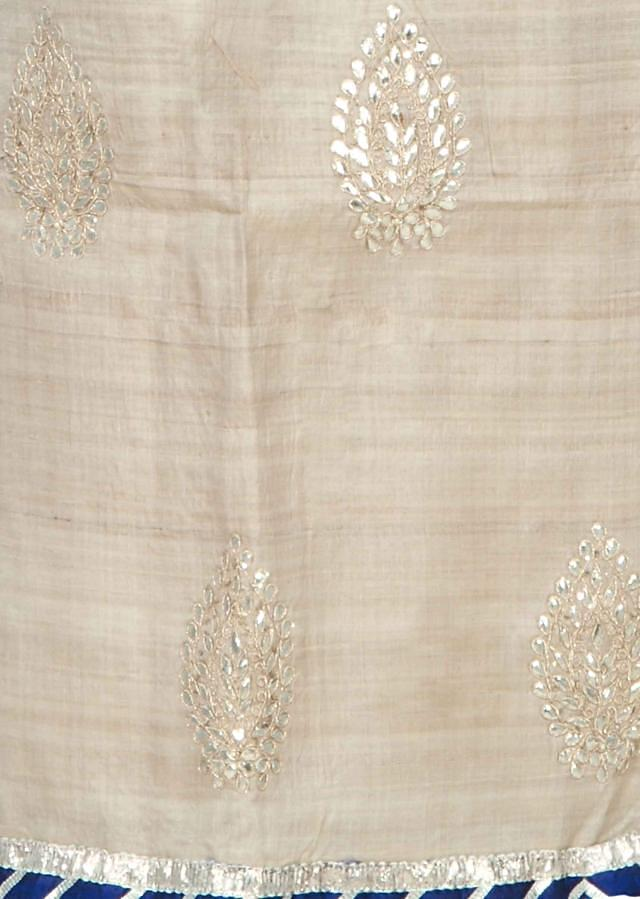 Cream unstitched suit with gotta patch butti only on Kalki