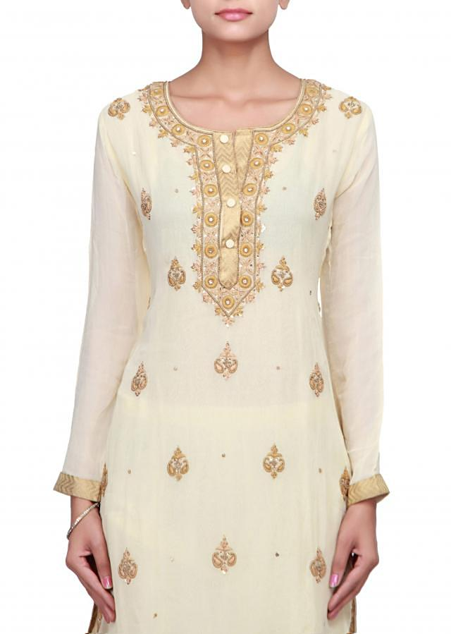 Cream straight suit embellished in embroidered butti only on Kalki