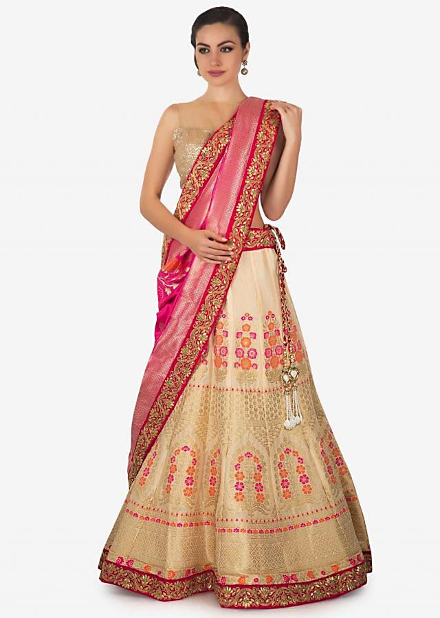 Cream lehenga in brocade silk with contrast dupatta only on Kalki