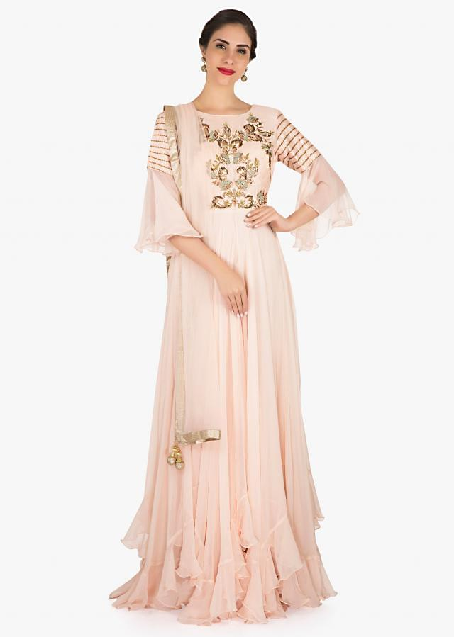 Cream anarkali gown in georgette highly embellished with resham and zari embroidery work only on Kalki