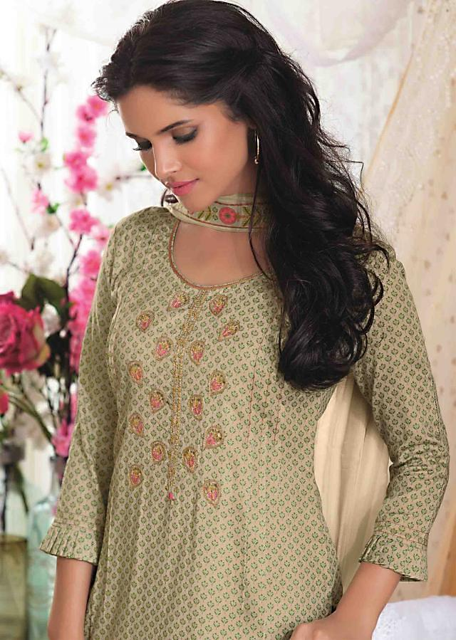 Cream and green unstitched printed suit with embroidered placket only on Kalki