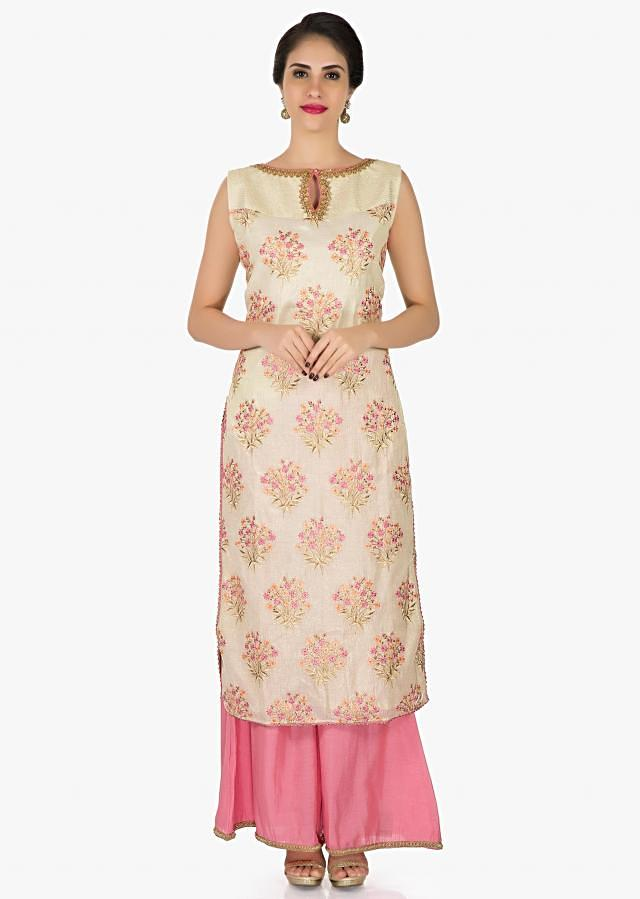 Cream and pink silk suit with scarf beautified in resham and sequin work only on Kalki