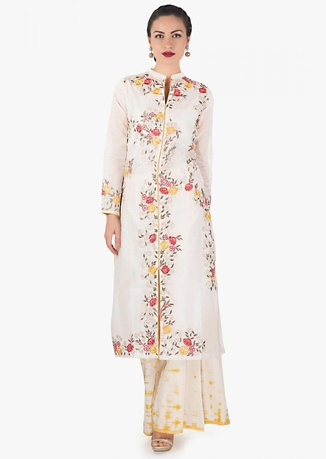 Cream and yellow semi stitched palazzo suit in silk with floral and zari embroidery only on Kalki