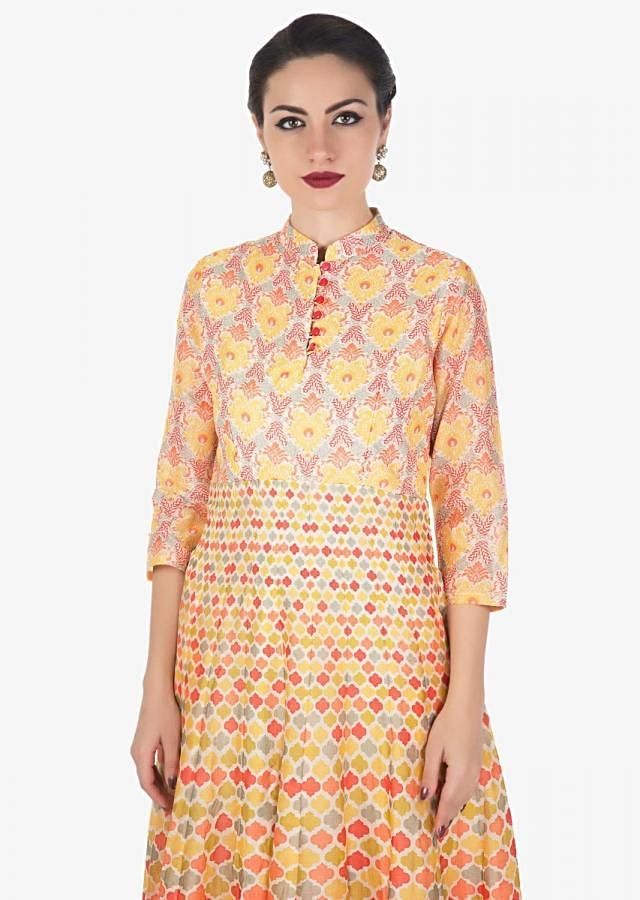 Cream base long kurti in yellow and peach print all over only on Kalki
