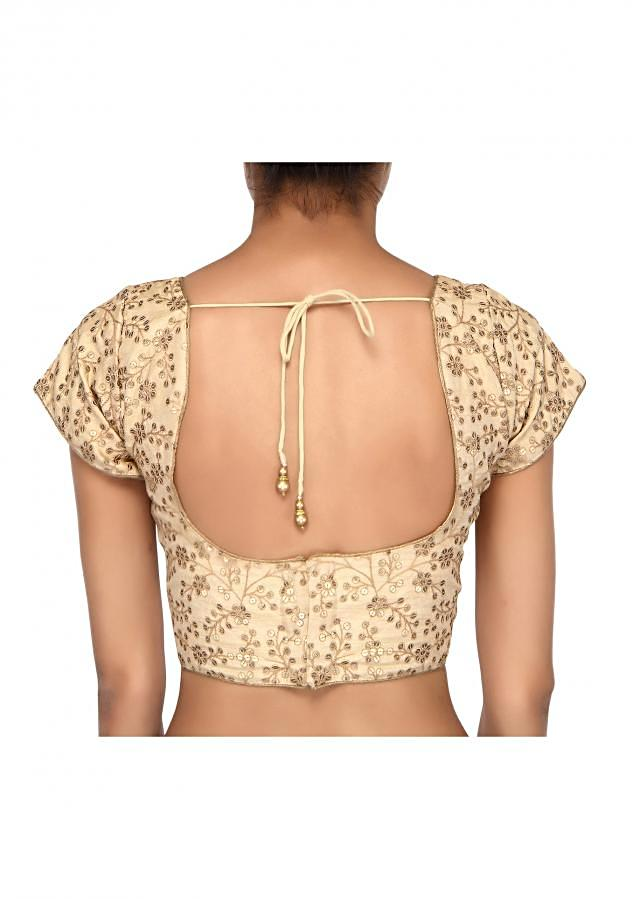 Cream blouse adorn in sequin embroidery only on Kalki
