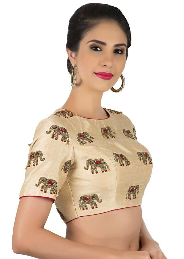 Cream blouse in raw silk with elephant motif embroidery in zardosi only on Kalki