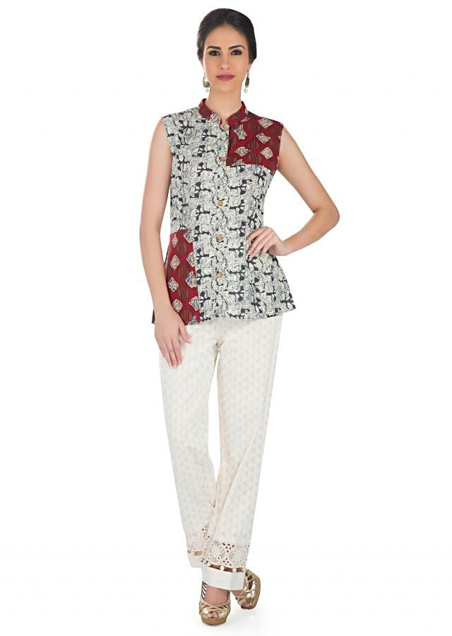 Cream Cotton Top Enhanced with Ethnic Prints  only on Kalki
