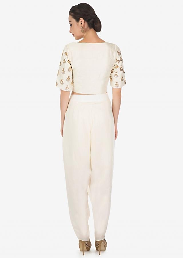 Cream dhoti pants matched with crop top blouse in gotta patch butti only on Kalki