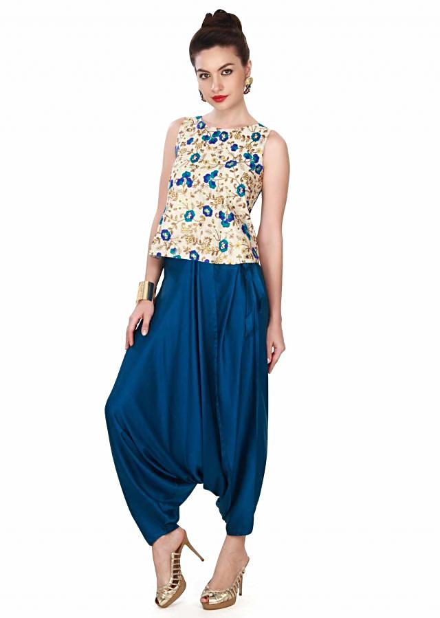 Cream embellished top matched with aladdin pants only on Kalki