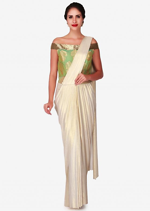 Cream foil saree gown with green brocade bodice only on Kalki