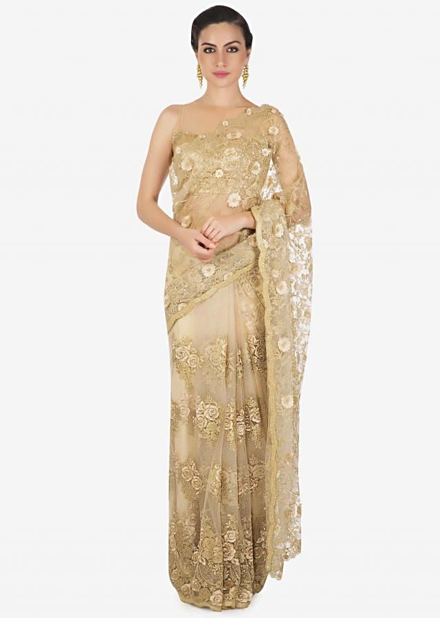 Cream gold saree adorn in cod, resham and zari embroidery only on Kalki