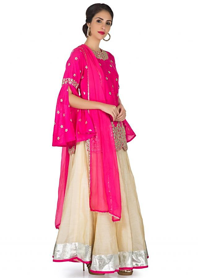 Cream lehenga matched with gotta patch embroidered long hot pink blouse only on Kalki