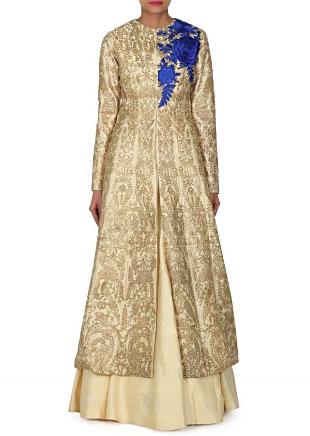 Cream lehenga matched with long jacket blouse only on Kalki