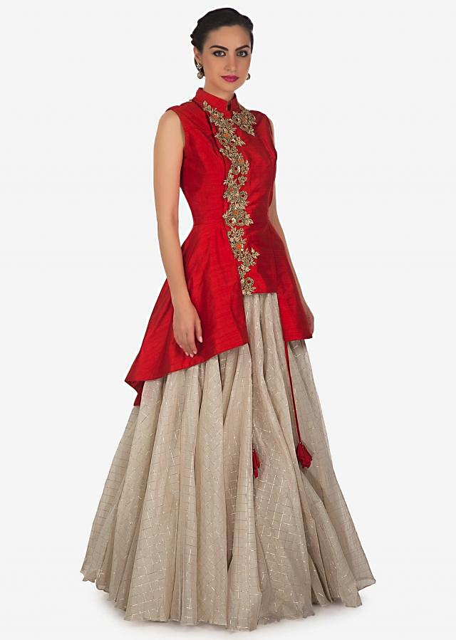 Cream lehenga matched with red jacket blouse adorn in french knot embroidery only on Kalki