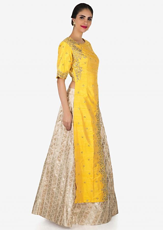 Cream lehenga with long yellow embroidered top only on Kalki