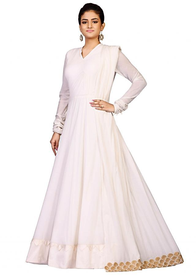 Cream plain suit in cotton constructed with artful zari and gold embroidery only on Kalki