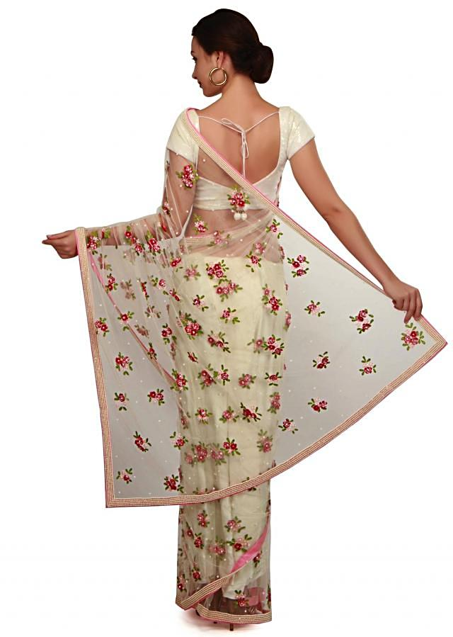 Cream saree in 3D flower and sequin butti only on Kalki