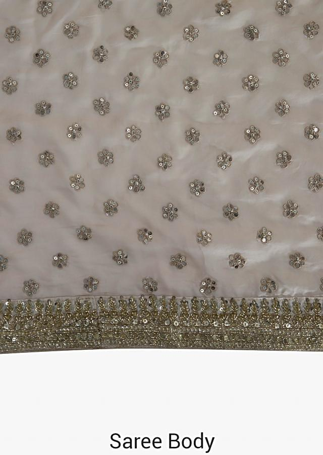 Cream saree in silk embellished with sequin butti embroidery work only on Kalki