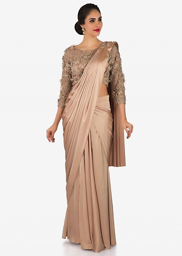 Cream satin pre-stitched saree with net blouse embellished with 3D flowers only on Kalki