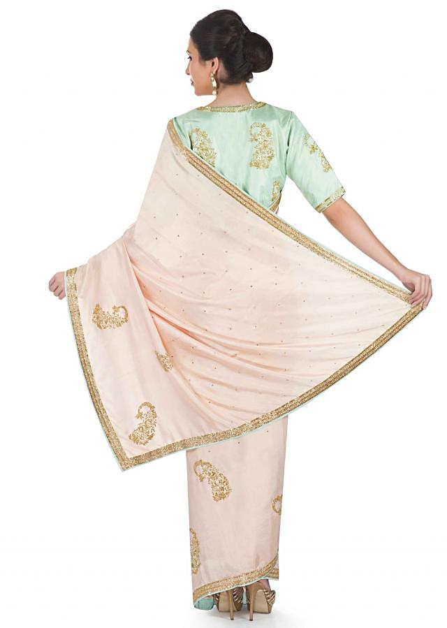 Cream Satin Saree Featuring Cut Dana on Paisley Motifs and Mint Green Silk Pre-Stitched Blouse only on Kalki