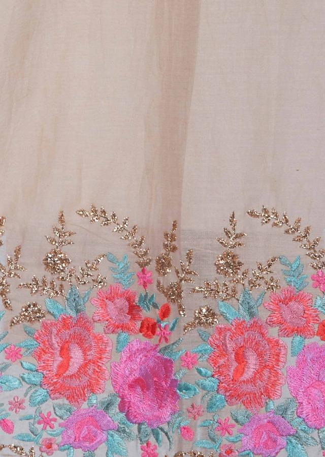Cream semi stitched suit with embroidered neckline and hem only on Kalki