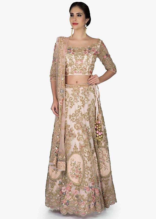 Cream Silk Lehenga Blouse Ensemble Crafted with Floral Embroidered Motifs only on Kalki