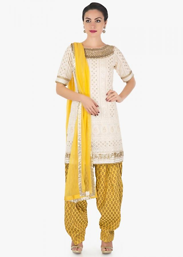 Cream straight suit in thread and sequin work with yellow salwar and net dupatta only on Kalki