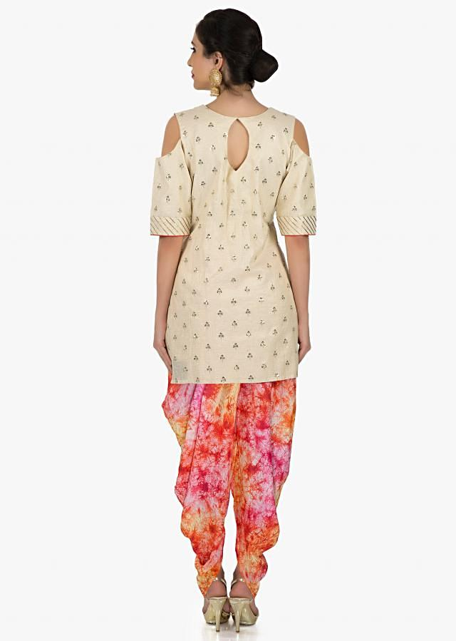Cream suit with multi colored dhoti pants featuring sequin butti work only on Kalki