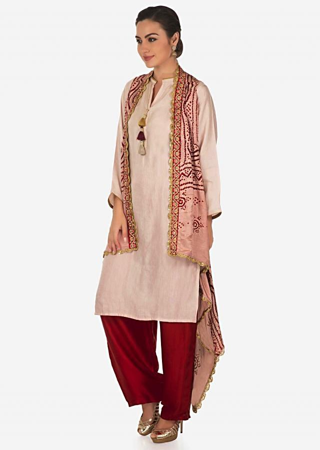 Cream suit with straight tassel matched with bandhani jacket only on Kalki