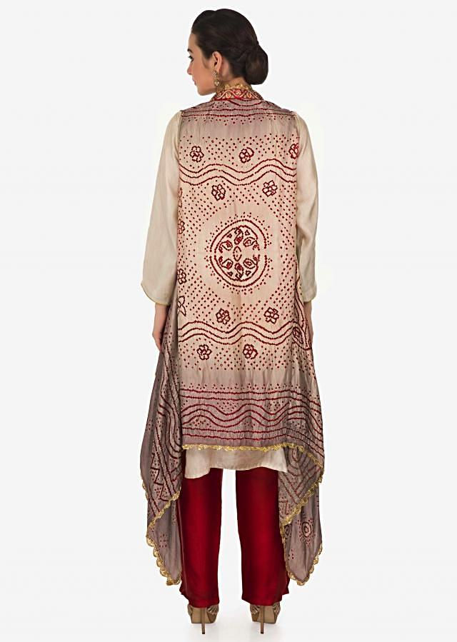 Cream suit with  tassel matched with bandhani jacket only on Kalki